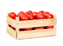 Fresh tomatoes in wooden box Royalty Free Stock Photo