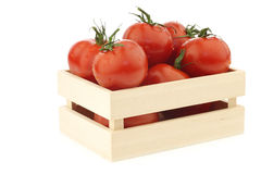 Fresh tomatoes in a wooden box Stock Image
