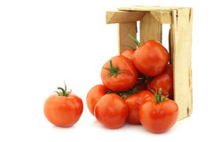 Fresh tomatoes in a wooden crate Stock Photography