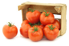 Fresh tomatoes in a wooden crate Royalty Free Stock Images
