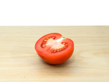 Fresh tomatoes on wooden plate. The fresh tomatoes on wooden plate Stock Photography