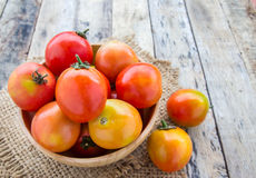Fresh tomatoes on wooden table Stock Photography