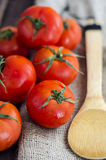 Fresh tomatoes on wooden table Stock Photos