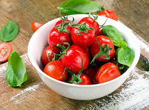 Fresh tomatoes on  wooden table. Stock Photography