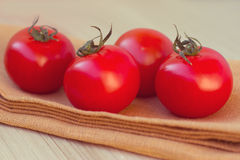 Fresh tomatoes on a wooden table Stock Image