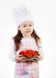 Fresh Tomatoes. A young girl uses fresh tomatoes to make something good to eat stock image