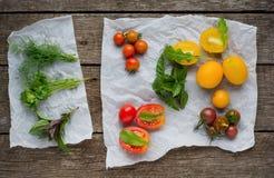 Fresh tomatos. Dill, basil and parsley tomatos  Stock Images