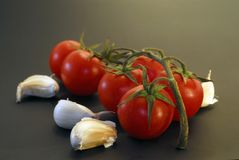 Fresh tomatos and garlic Royalty Free Stock Photo