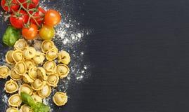 Fresh tortellini with basil ad tomatoes Stock Photo