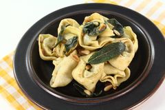 Fresh tortellini with sage butter Stock Photography