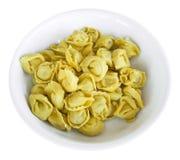 Fresh Tortellini on white dish. Fresh raw tortellini on white dish Royalty Free Stock Photos