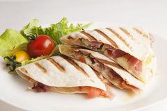 Fresh tortilla on a plate close up. With tomatoes and salad Royalty Free Stock Photography