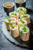 Fresh tortilla with vegetables, cheese and herbs for a brunch. On black rock Stock Photography