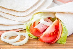 Fresh tortilla with vegetables and ham. Fresh tortilla with tomato, onion and ham Stock Photography