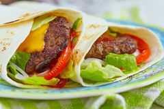 Fresh tortilla wrap with grilled beef burger Stock Image