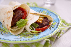 Fresh tortilla wrap with grilled beef burger Stock Photography