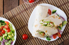 Fresh tortilla wraps with chicken and fresh vegetables Royalty Free Stock Photos