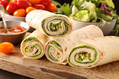 Fresh tortilla wraps with ham cheese and vegetables Royalty Free Stock Image
