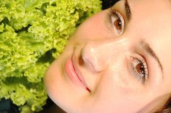 Fresh touch. Pretty girl feeling the tender touch of a fresh salad Royalty Free Stock Image