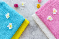 Fresh towel after washing on grey stone background top view Royalty Free Stock Photography