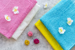Fresh towel after washing on grey stone background top view Stock Images