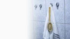 Fresh towels hang in the bathroom on the hook stock photography