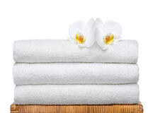Fresh Towels with white Orchids. Three Fresh and clean Towels with white Orchids. Iso 100 Royalty Free Stock Image