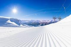 Fresh tracks of snowcat at the ski resort slopes Royalty Free Stock Photos