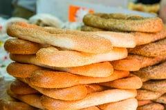 Fresh traditional jewish pastry - buns, Challah, bread for Shabbat on Tel Aviv marketplace. Selective focus. Space for text. Fresh traditional jewish pastry Royalty Free Stock Photo