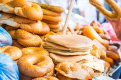 Fresh traditional jewish pastry - buns, Challah, pitta bread for Shabbat on Tel Aviv marketplace. Selective focus. Space for text. Fresh traditional jewish Stock Images