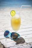 Fresh tropical cocktail with rum on beautiful sunny beach Stock Photos