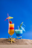 Fresh tropical cocktail on sunny beach Stock Images