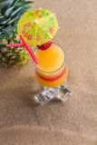 Fresh tropical cocktail on sunny beach Stock Photo