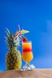 Fresh tropical cocktail on sunny beach Stock Photos