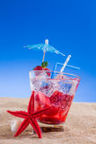 Fresh tropical cocktail on sunny beach Stock Photography