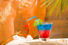 Fresh tropical cocktail on sunny beach in Maldives Stock Photo