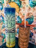 Fresh tropical cocktails served in ceramic Tiki style glasses royalty free stock images