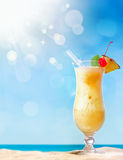 Fresh tropical coctail on sunny beach royalty free stock images