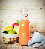 Fresh tropical fruit juice in a glass bottle royalty free stock images