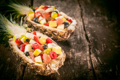 Fresh Tropical Fruit Salads in Pineapple Boats Royalty Free Stock Image