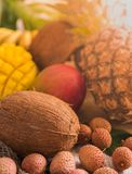 Fresh tropical fruit on wood top view. bananas, pineapple, coconut, mango, lychee, chestnuts. Toned. Fresh tropical fruit on wood top view. bananas, pineapple stock photo