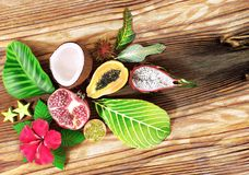 Fresh tropical fruit on wooden background, Top view. Royalty Free Stock Photography