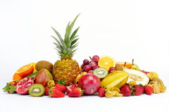 Fresh tropical fruits against white Stock Photos