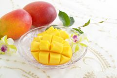 Fresh tropical fruits. Fresh fruits on the dining table royalty free stock image