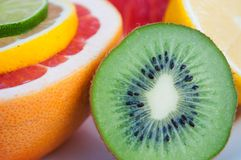 Fresh tropical fruits - lemon, kiwi, red grapefruit Royalty Free Stock Photos