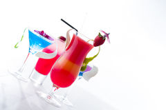 Fresh tropical layered cocktails over white Royalty Free Stock Image