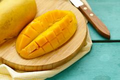 Fresh tropical mango fruit. On a wooden background Stock Photography