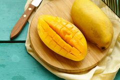 Fresh tropical mango fruit. On a wooden background Stock Photos