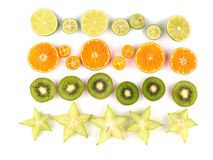 Close-up of a ripe exotic slices of fruits isolated on a white background. stock photos