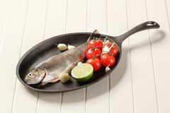 Fresh trout on a cast iron skillet Stock Image